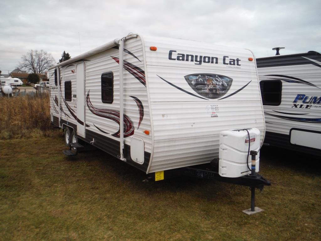 Frontal View of a 2015 PALOMINO Canyon Cat, 27FQC
